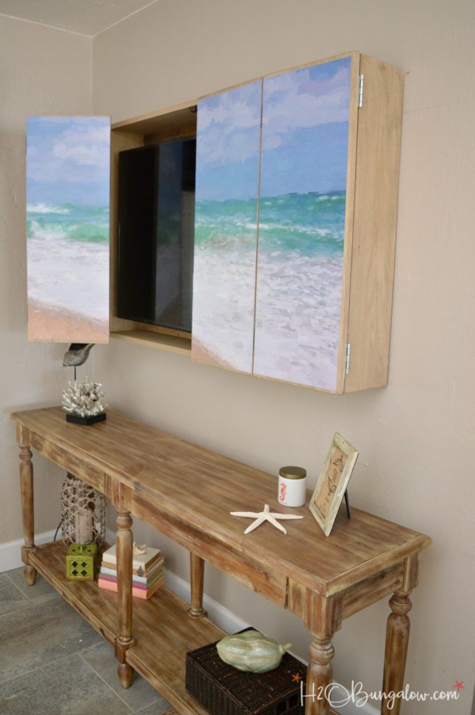 wall mounted tv cabinet hides TV
