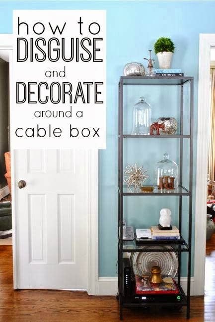 Disguise cable box on wall shelf