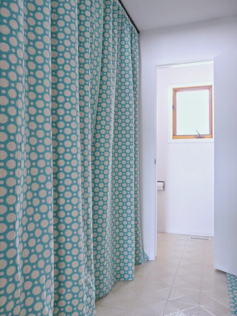 use curtains to hide a section of a room