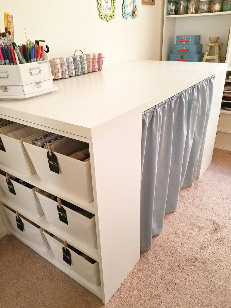 hide craft clutter behind curtains in shelves