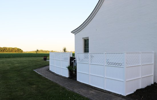 hidden pool pump behind fence