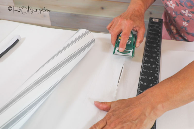taping two pieces of drawer liner together