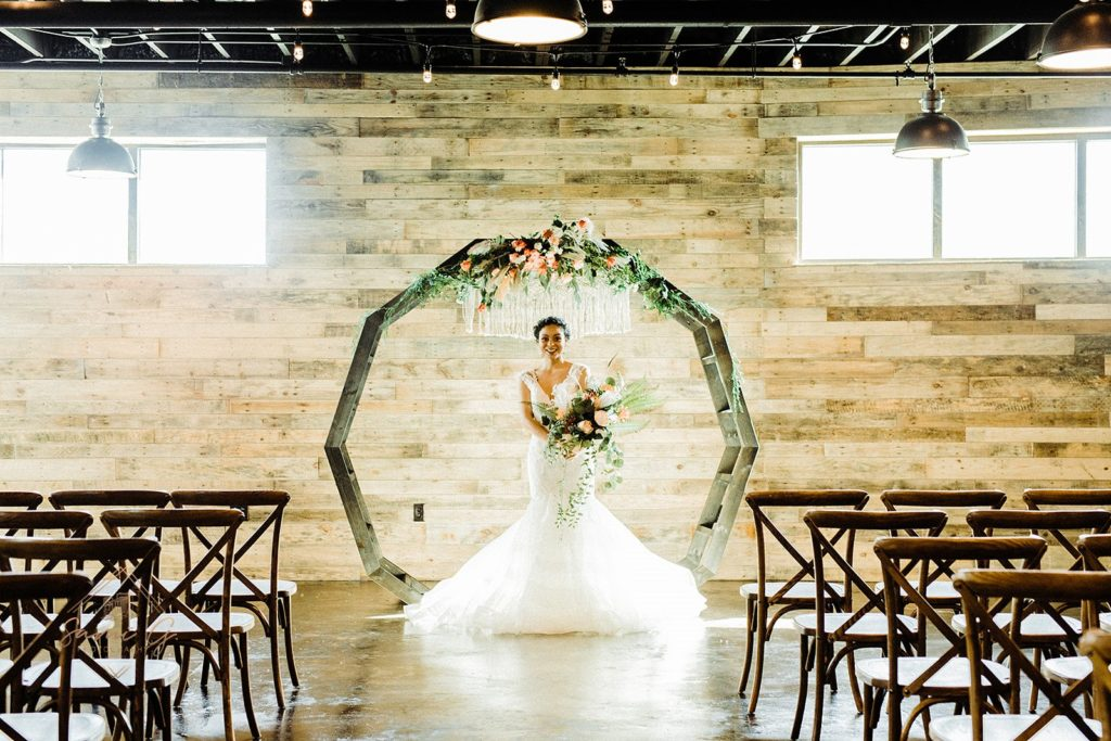 bride with DIY moon gate arch