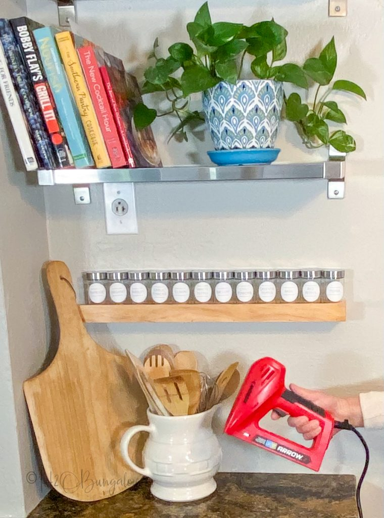 Spice Rack hanging on wall with stapler