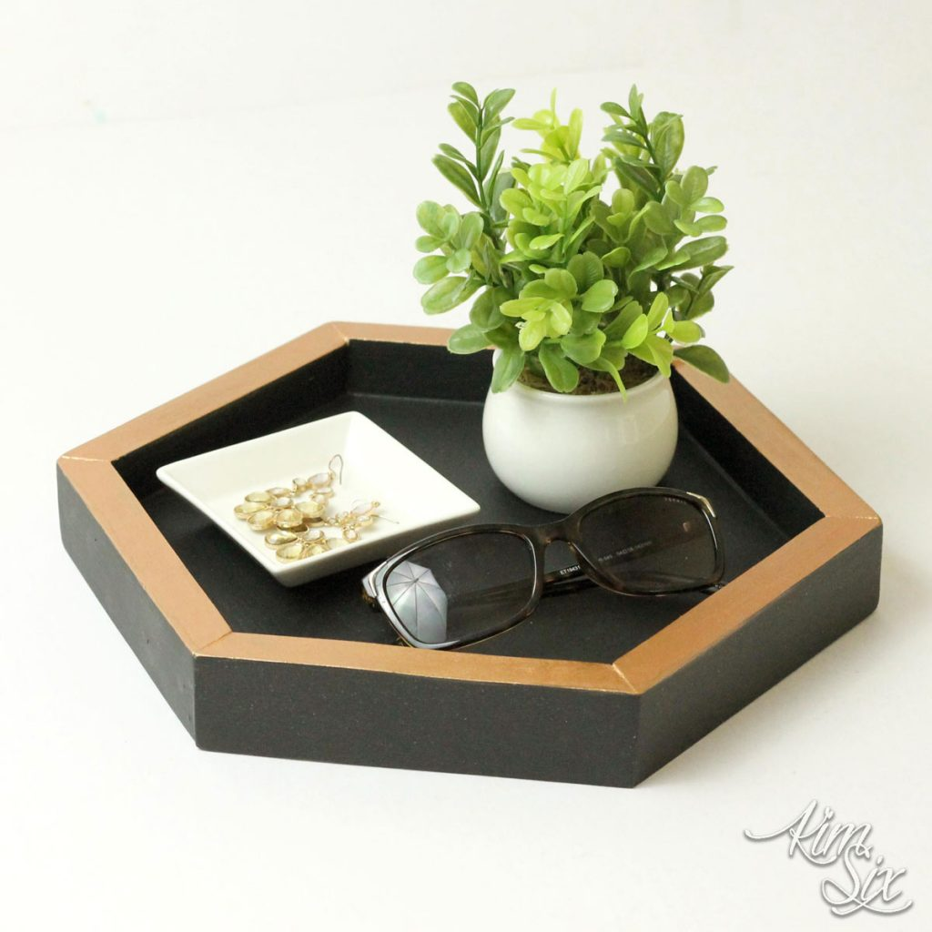 hexagon shaped tray with a plant and sunglasses