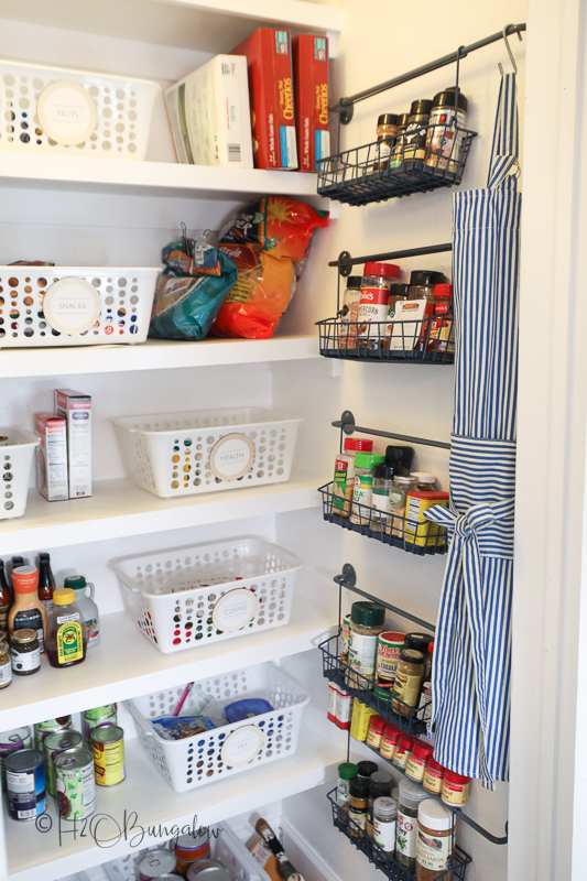 pantry organized for more space with bins