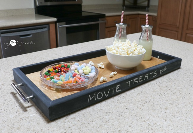 serving tray with chalkboard painted trim and popcorn in a bowl