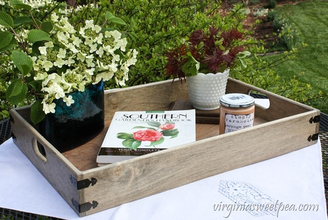 serving tray with flowers and book