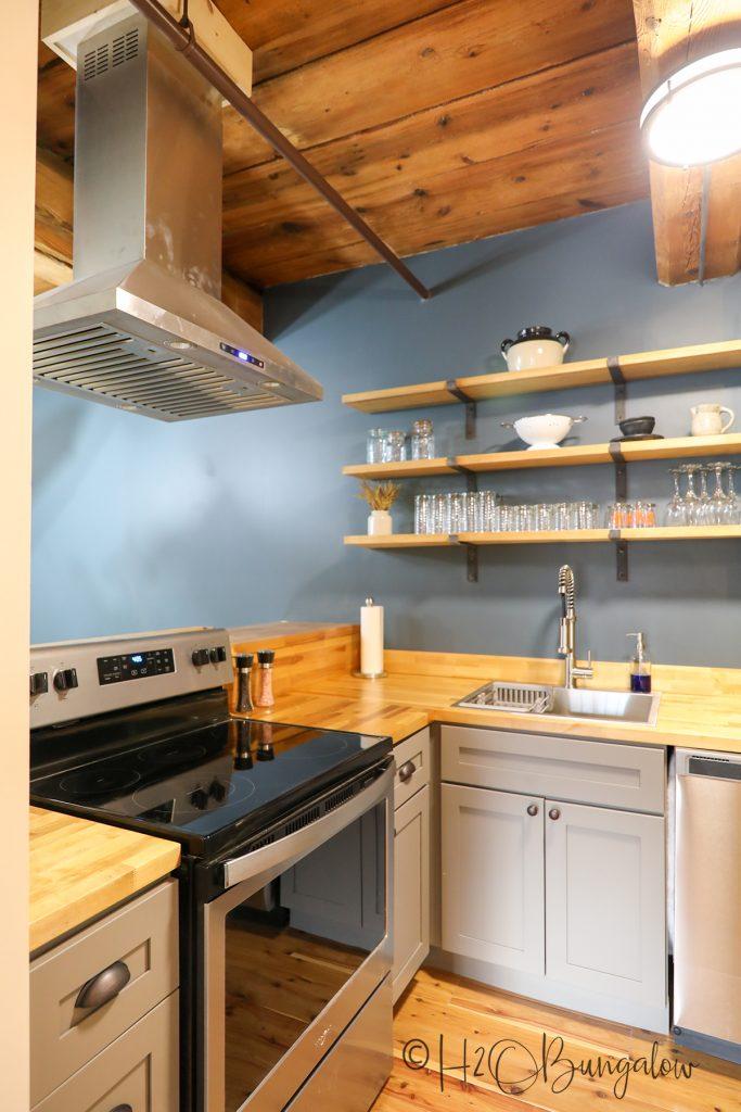 DIY wood countertop installed in rustic kitchen