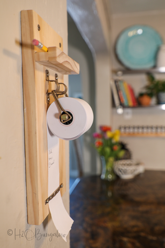DIY paper roll note holder on wall in kitchen