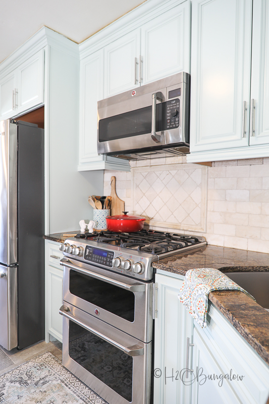 blue cabinets with 6 burner stove