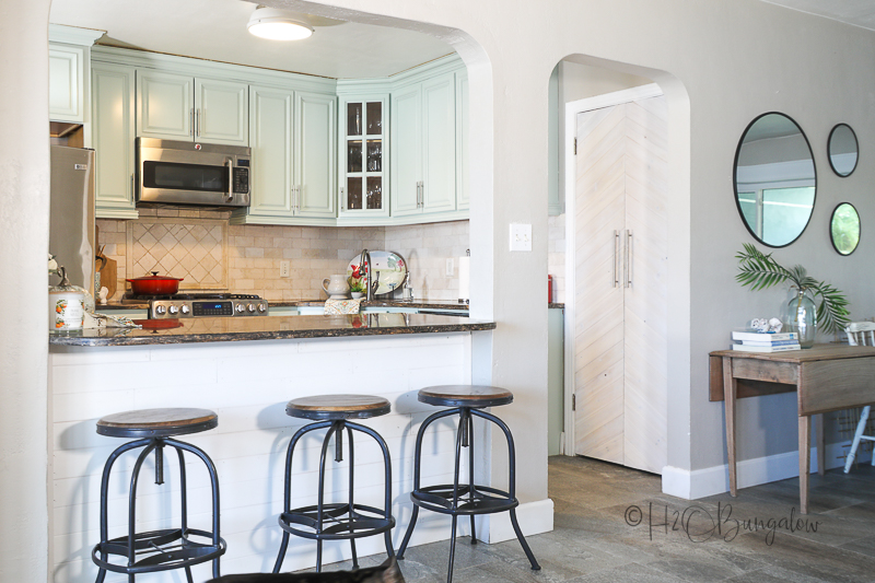 coastal vibe with light blue painted kitchen cabinets