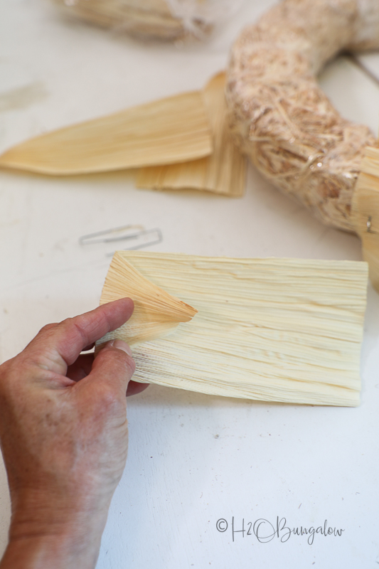 step 1 to make corn husk wreath, fold corn husk