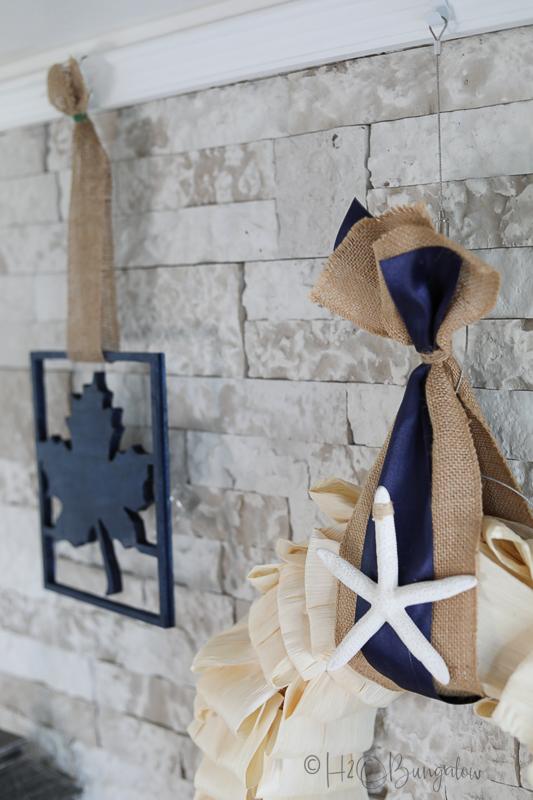 decorative blue ribbon and starfish on coastal  fall corn husk wreath